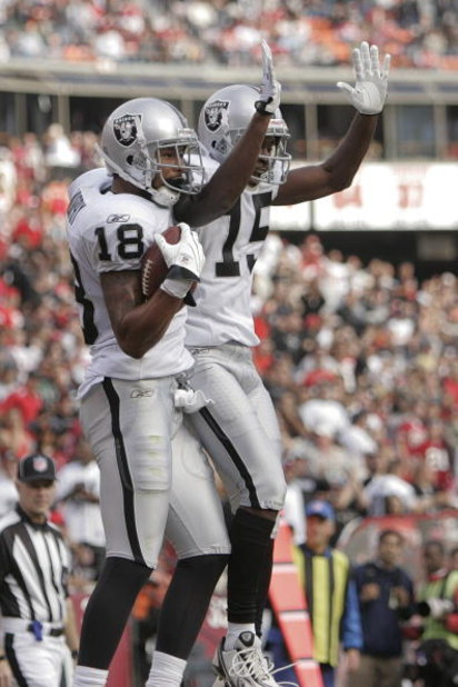 SAN FRANCISCO - AUGUST 22:  Oakland Raiders wide receiver Louis Murphy #18 raises celebrates with Oakland Raiders wide receiver Johnnie Lee Higgins #15 after making a touchdown in the 2nd quarter as the San Francisco 49ers host the Oakland Raiders at Cand
