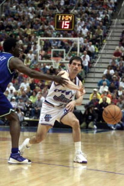 21 Apr 2001:  John Stockton #12 of the Utah Jazz in action against the Dallas Mavericks during game one of the NBA playoffs at the Delta Center in Salt Lake City, Utah.  The Jazz won 88-86.  DIGITAL IMAGE.  Mandatory Credit: Brian Bahr/Allsport