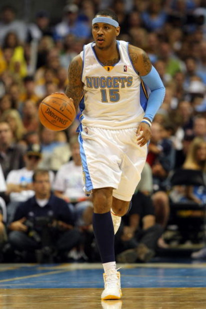 DENVER - MAY 29:  Carmelo Anthony #15 of the Denver Nuggets moves the ball in Game Six of the Western Conference Finals during the 2009 NBA Playoffs against the Los Angeles Lakers at Pepsi Center on May 29, 2009 in Denver, Colorado. NOTE TO USER: User exp