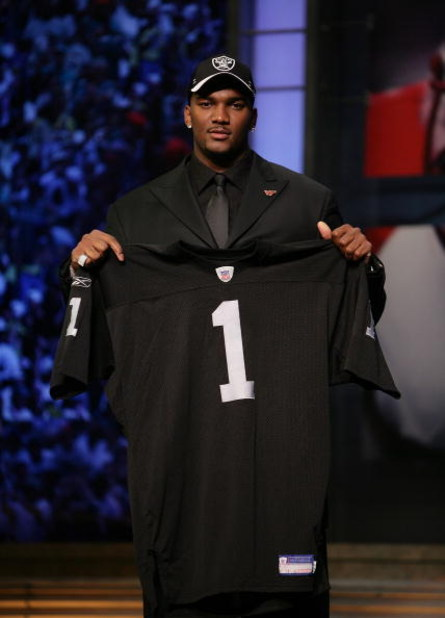 NEW YORK - APRIL 28:  JaMarcus Russell poses with his Oakland Raiders jersey after being chosen first overall by the Oakland Raiders at the 2007 NFL Draft at Radio City Music Hall April 28, 2007 in New York City.  (Photo by Nick Laham/Getty Images)
