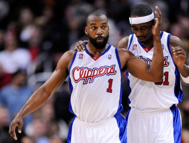 LOS ANGELES, CA - FEBRUARY 18:  Baron Davis #1 of the Los Angeles Clippers consoles Ricky Davis #31 during their , 142-119, loss to the Phoenix Suns at the Staples Center February 18, 2009, in Los Angeles, California. NOTE TO USER: User expressly acknowle