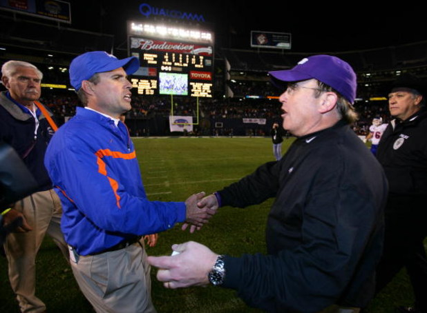 SAN DIEGO, CA - DECEMBER 23:  Head Coach Chris Petersen of the Boise State Broncos meets Heads Coach Gary Patterson of TCU Horned Frogs after the Horned Frogs 17-16 win over the Broncos during the San Diego County Credit Union Poinsettia Bowl at Qualcomm