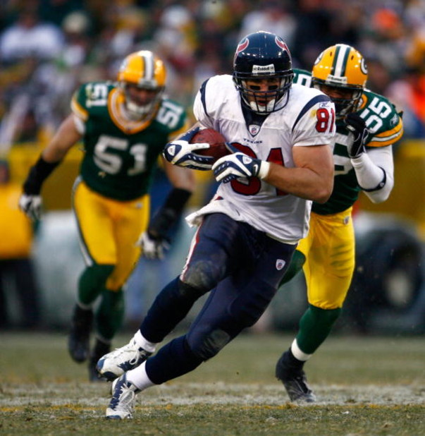 GREEN BAY, WI - DECEMBER 07:  Owen Daniels #81 of the Houston Texans carries the ball while being pursued by Desmond Bishop #55 of the Green Bay Packers during the fourth quarter at Lambeau Field on December 7, 2008 in Green Bay, Wisconsin. The Texans def