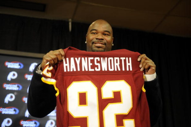 ASHBURN, VA - FEBRUARY 27:  Albert Haynesworth posese with his new jersey at a press conference after signing a 7-year contract worth approximately $100 million with the Washington Redskins on February 27, 2009 at Redskins Park in Ashburn, Virginia.  (Pho