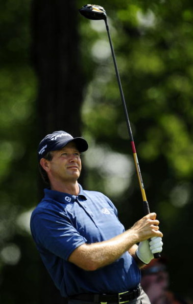 CHASKA, MN - AUGUST 11:  Retief Goosen of South Africa watches his shot during the second preview day of the 91st PGA Championship at Hazeltine National Golf Club on August 11, 2009 in Chaska, Minnesota.  (Photo by Sam Greenwood/Getty Images)