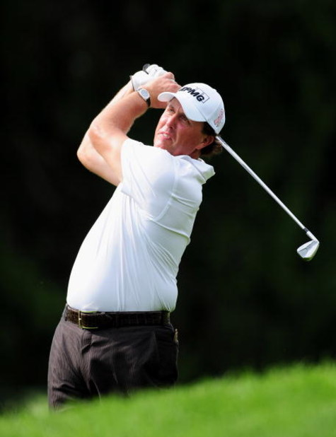 AKRON, OH - AUGUST 07:  Phil Mickelson of USA plays his approach shot on the 14th hole during the second round of the World Golf Championship Bridgestone Invitational on August 7, 2009 at Firestone Country Club in Akron, Ohio.  (Photo by Stuart Franklin/G