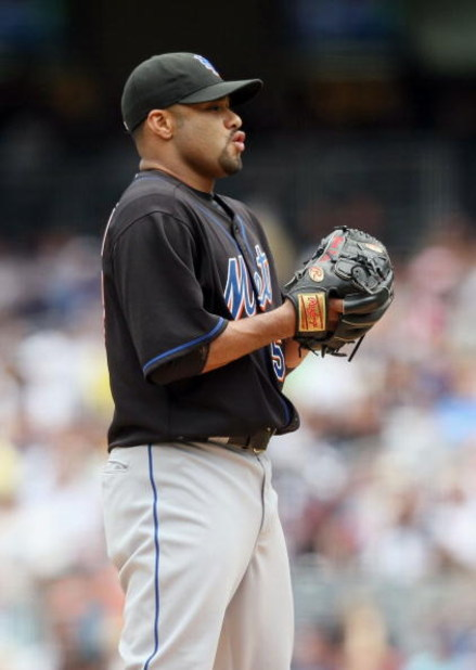 NEW YORK - JUNE 14:  Johan Santana #57 of the New York Mets pitches against the New York Yankees on June 14, 2009 at Yankee Stadium in the Bronx borough of New York City.  (Photo by Nick Laham/Getty Images)