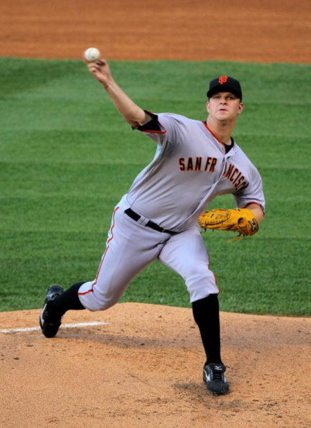 DENVER - JULY 24:  Starting pitcher Matt Cain #18 of the the San Francisco Giants delivers against the Colorado Rockies at Coors Field on July 24, 2009 in Denver, Colorado.  (Photo by Doug Pensinger/Getty Images)