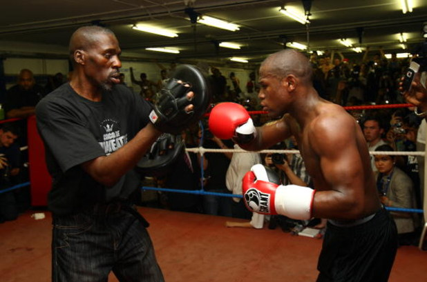 LONDON, ENGLAND - MAY 22:  Boxing superstar Floyd Mayweather in his first open workout since coming out of retirement with trainer and uncle Roger Mayweather, as he prepares for his fight against Juan Manuel Marquez of Mexico, at Peacock Gym on May 22, 20