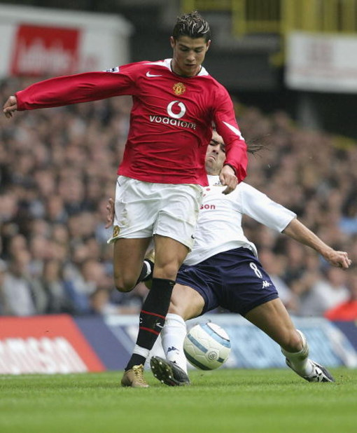 LONDON - SEPTEMBER 25:  Cristiano Renaldo of Manchester United is tackled by Pedro Mendes of Spurs during the Barclays Premiership match between Tottenham Hotspur and Manchester United on September 25, 2004 at White Hart Lane, London, England. (Photo by J