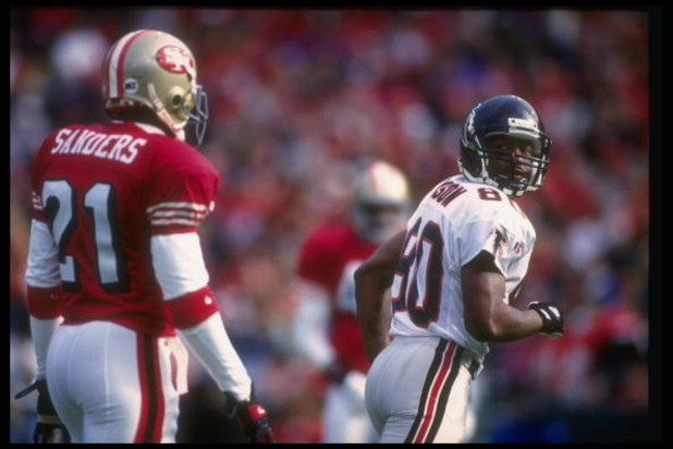 4 Dec 1994:  Wide receiver Andre Rison of the Atlanta Falcons (right) moves away from San Francisco 49ers defensive back Deion Sanders during a game at Candlestick Park in San Francisco, California.  The 49ers won the game, 50-14. Mandatory Credit: Otto G