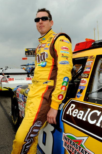 WATKINS GLEN, NY - AUGUST 09: Kyle Busch, driver of the #18 M&Ms Toyota, stands next to his car on the grid prior to the NASCAR Sprint Cup Series Heluva Good! Sour Cream Dips at Watkins Glen International on August 9, 2009 in Watkins Glen, New York.  (Pho