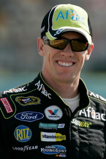WATKINS GLEN, NY - AUGUST 07:  Carl Edwards, driver of the # Aflac Ford, walks down pit road during qualifying for the NASCAR Sprint Cup Series Heluva Good! Sour Cream Dips at Watkins Glen International on August 7, 2009 in Watkins Glen, New York.  (Photo