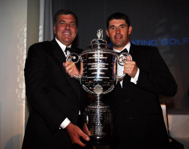 WENTWORTH, ENGLAND - MAY 19:  Padraig Harrington of Ireland (right) poses with the Wanamaker trophy alongside Brian Whitcomb, PGA of America Honorary President, during The European Tour Dinner at the BMW PGA Championship at Wentworth on May 19, 2009 in Vi