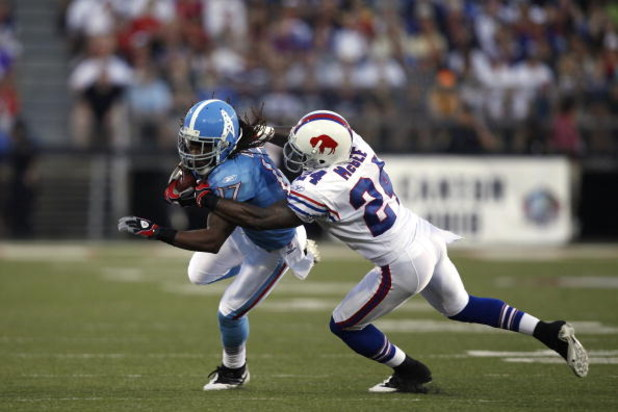 CANTON, OH - AUGUST 9: Chris Davis #17 of the Tennessee Titans tries to get around Terrence McGee #24 of the Buffalo Bills during the Pro Football Hall of Fame Game at Fawcett Stadium on August 9, 2009 in Canton, Ohio. The Titans defeated the Bills 21-18.