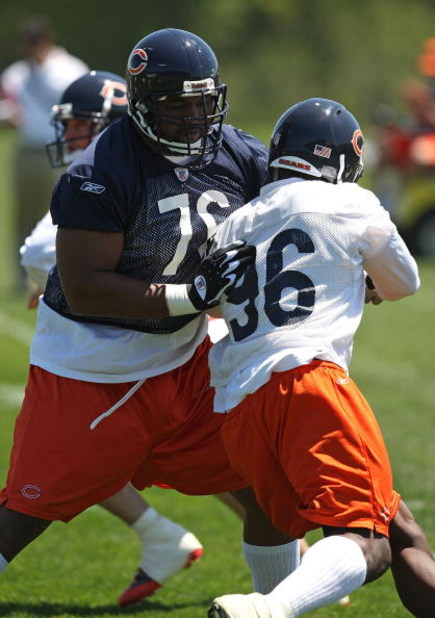 LAKE FOREST, IL - MAY 20: Orlando Pace #76 of the Chicago Bears blocks Alex Brown #96 during an organized team activity (OTA) practice on May 20, 2009 at Halas Hall in Lake Forest, Illinois. (Photo by Jonathan Daniel/Getty Images)