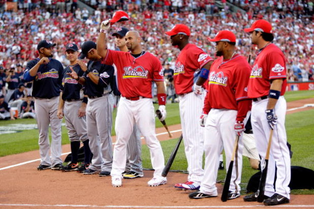 ST LOUIS, MO - JULY 13:  National League All-Star Albert Pujols of the St. Louis Cardinals tips his cap to the crowd before the State Farm Home Run Derby at Busch Stadium on July 13, 2009 in St. Louis, Missouri.  (Photo by Jamie Squire/Getty Images)