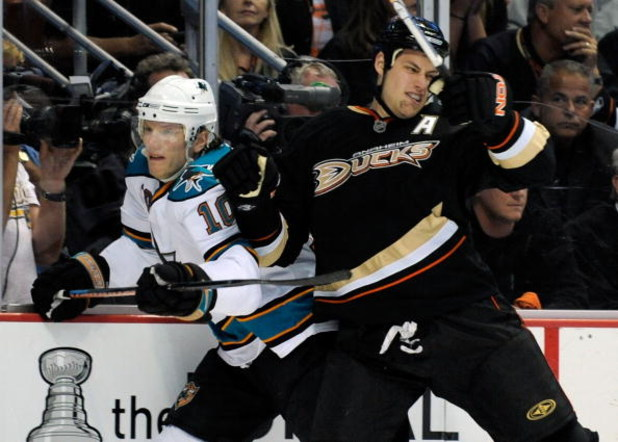 ANAHEIM, CA - APRIL 23:   Ryan Getzlaf #15 of the Anaheim Ducks checks Christian Ehrhoff #10 of the San Jose Sharks in the first period during Game Four of the Western Conference Quarterfinal Round of the 2009 Stanley Cup Playoffs at Honda Center on April