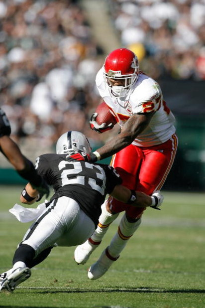 OAKLAND - October 21:  Running back Larry Johnson #27 of the Kansas City Chiefs is tackled by defensive back Chris Carr #23 of the Oakland Raiders at McAfee Coliseum October 21, 2007 in Oakland, California. California. Kansas City won 12-10.  (Photo by Gr