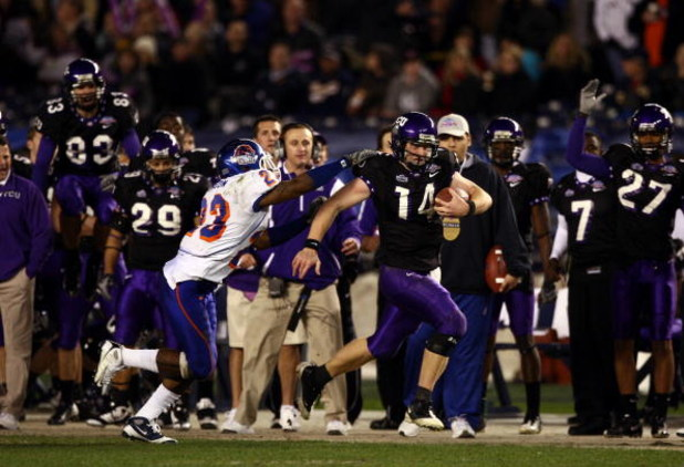 SAN DIEGO, CA - DECEMBER 23:  Quarterback Andy Dalton #14 of  TCU runs with the ball against the tackle of Safety Jeron Johnson #23 of Boise State during the San Diego County Credit Union Poinsettia Bowl at Qualcomm Stadium on December 23, 2008 in San Die