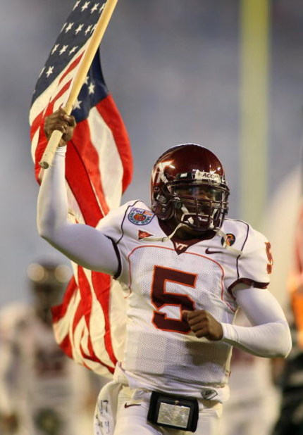 MIAMI - JANUARY 03:  Quarterback Tyrod Taylor #5 of the Virginia Tech Hokies runs on to the field holding the American flag before taking on the Kansas Jayhawks in the FedEx Orange Bowl at Dolphin Stadium on January 3, 2008 in Miami, Florida.  (Photo by M