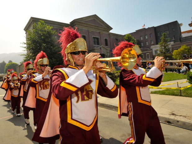UNIVERSAL CITY, CA - JUNE 18:  The USC marching band performs at celebration of the re-opening of Courthouse Square at Universal Studios Hollywood on June 18, 2009 in Universal City, California. Courthouse Square has been fully restored following a four a