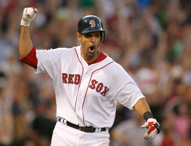 BOSTON - APRIL 25: Mike Lowell #25 of the Boston Red Sox celebrates as he rounds the bases after hitting a home run against the New York Yankees at Fenway Park, April 25, 2009, in Boston, Massachusetts. (Photo by Jim Rogash/Getty Images)