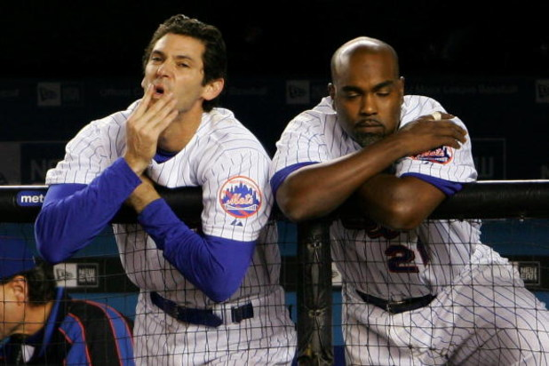 NEW YORK - SEPTEMBER 28: Shawn Green #20 and Carlos Delgado #21 of the New York Mets watch on from the dugout in the bottom of the nineth inning against the Florida Marlins during the MLB game at Shea Stadium on September 28, 2007 in the Flushing neighbor