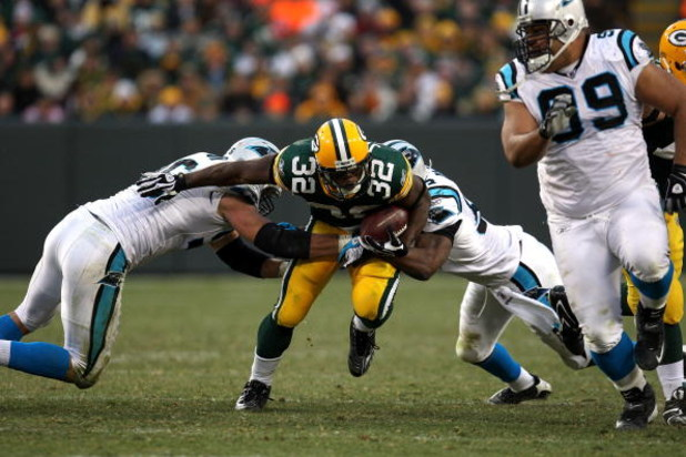 GREEN BAY, WI - NOVEMBER 30:  Brandon Jackson #32 of the Green Bay Packers runs the ball against the Carolina Panthers at Lambeau Field on November 30, 2008 in Green Bay, Wisconsin. The Panthers won 35-31.  (Photo by Jonathan Daniel/Getty Images)