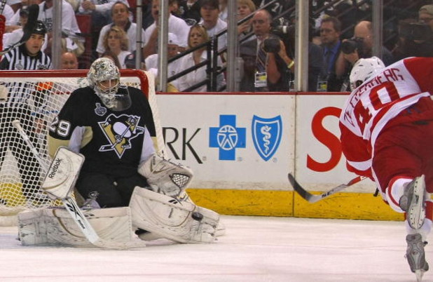 PITTSBURGH - JUNE 09:  Goaltender Marc-Andre Fleury #29 of the Pittsburgh Penguins saves a shot by Henrik Zetterberg #40 of the Detroit Red Wings during Game Six of the NHL Stanley Cup Finals at the Mellon Arena on June 9, 2009 in Pittsburgh, Pennsylvania