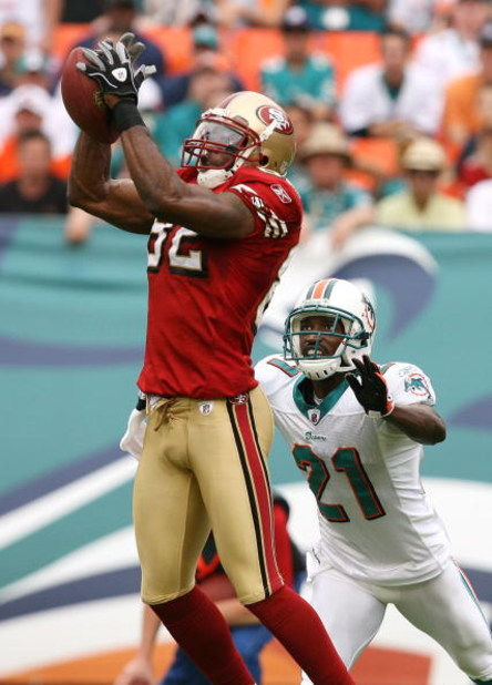 MIAMI - DECEMBER 14:  Wide receiver Bryant Johnson #82 of the San Francisco 49ers catches a pass in front of cornerback Andre Goodman #21 of the Miami Dolphins at Dolphin Stadium on December 14, 2008 in Miami, Florida. The Dolphins defeated the 49ers 14-9