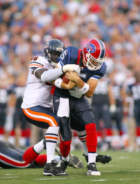ORCHARD PARK, NY - AUGUST 15:  Trent Edwards #5  of the Buffalo Bills is tackled by Alex Brown #96 of  the Chicago Bears on August 15, 2009 at Ralph Wilson Stadium in Orchard Park, New York.  (Photo by Rick Stewart/Getty Images)