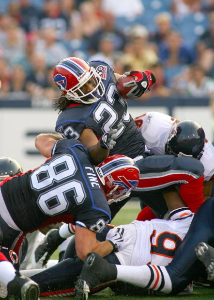 ORCHARD PARK, NY - AUGUST 15: Marshawn Lynch #23 of the Buffalo Bills falls over a pile of players against the Chicago Bears on August 15, 2009 at Ralph Wilson Stadium in Orchard Park, New York.  (Photo by Rick Stewart/Getty Images)