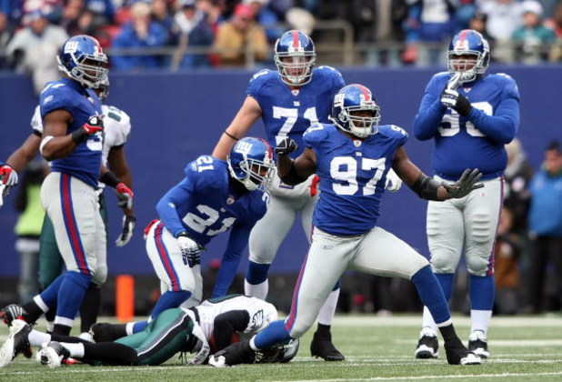 EAST RUTHERFORD, NJ - DECEMBER 07: Mathias Kiwanuka #97 of the New York Giants celebrates a tackle agianst the Philadelphia Eagles at Giants Stadium on December 7, 2008 in East Rutherford, New Jersey.  (Photo by Nick Laham/Getty Images)