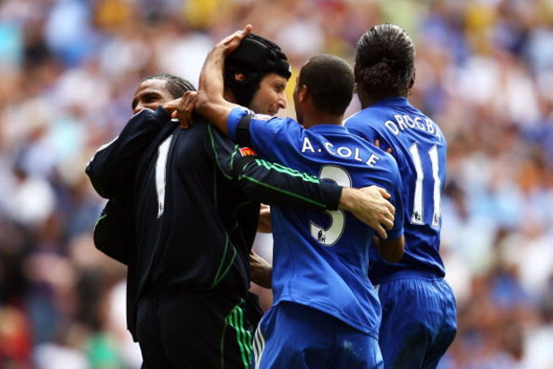 LONDON, ENGLAND - AUGUST 09:  Petr Cech, Ashley Cole and Didier Drogba of Chelsea celebrate victory in the penalty shoot out during the FA Community Shield match between Manchester United and Chelsea at Wembley Stadium on August 9, 2009 in London, England