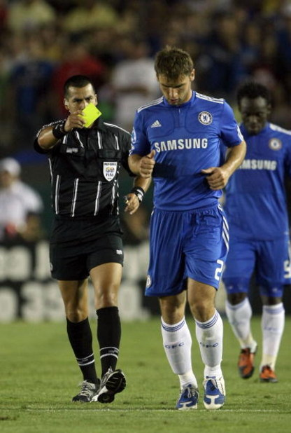 PASADENA, CA - JULY 21:  Branislav Ivanovich of Chelsea FC is shown the yellow card after fouling Mario Balotelli of Inter Milan (not in picture) during the World Football Challenge at the Rose Bowl on July 21, 2009 in Pasadena, California.  (Photo by Ste