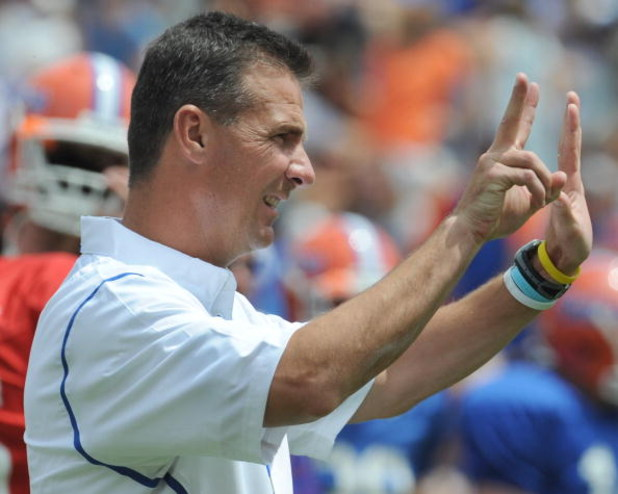 GAINESVILLE, FL - APRIL 18: Coach Urban Meyer of the University of Florida directs the spring football Orange and Blue game April 18, 2009 at Ben Hill Griffin Stadium in Gainesville, Florida.  (Photo by Al Messerschmidt/Getty Images)