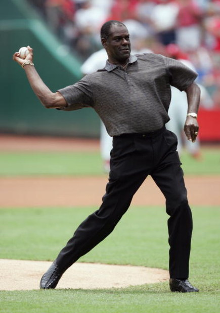 ST. LOUIS - JULY 5:  Former baseball player Bob Gibson throws out the ceremonial first pitch prior to the game between the St. Louis Cardinals and the Cincinnati Reds at Busch Stadium on July 5, 2004 in St. Louis, Missouri.  The Cardinals defeated the Red