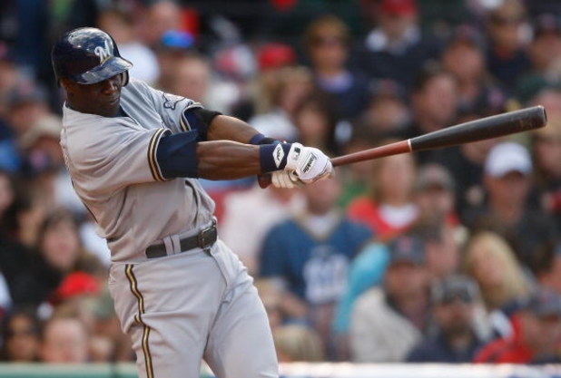 BOSTON - MAY 17:  Mike Cameron #25 of the Milwaukee Brewers connects for a two-run home run against the Boston Red Sox at Fenway Park on May 17, 2008 in Boston, Massachusetts. (Photo by Jim Rogash/Getty Images)