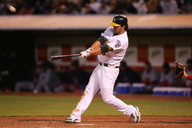 OAKLAND, CA - JUNE 04:  Eric Chavez #3 of the Oakland Athletics hits a walk off home run in the 11th inning against the Boston Red Sox during a Major League Baseball game on June 4, 2007 at McAfee Coliseum in Oakland, California.  (Photo by Jed Jacobsohn/