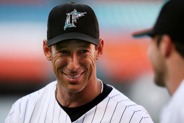 MIAMI - JUNE 07: Outfielder Luis Gonzalez #26 of the Florida Marlins warms up prior to playing against the Cincinnati Reds at Dolphin Stadium June 7, 2008 in Miami, Florida.  (Photo by Marc Serota/Getty Images)