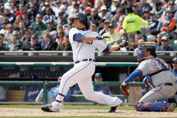 DETROIT - APRIL 10:  Magglio Ordonez #30 of the Detroit Tigers swings at the pitch against the Texas Rangers during Opening Day on April 10, 2009 at Comerica Park in Detroit, Michigan. Detroit won the game 15-2. (Photo by Gregory Shamus/Getty Images)