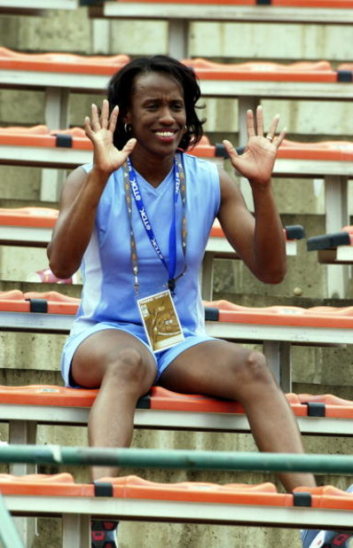 4 Aug 2001:  Jackie Joyner Kersee of the USA waves from the stands during the second day of the 8th IAAF World Athletic Championships in Edmonton Canada. DIGITAL IMAGE.  Mandatory Credit: Stu Forster/ALLSPORT