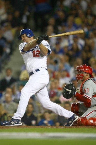 LOS ANGELES, CA - OCTOBER 15:  Jeff Kent #12 of the Los Angeles Dodgers swings at a pitch against the Philadelphia Phillies in Game Five of the National League Championship Series during the 2008 MLB playoffs on October 15, 2008 at Dodger Stadium in Los A