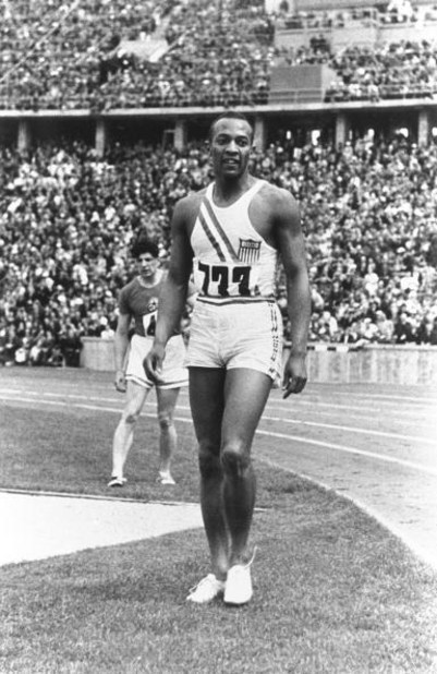 1-16 Aug 1936:  Jesse Owens of the USA relaxes between events at the 1936 Olympic Games in Berlin. Owens won four gold medals. \ Mandatory Credit: IOC Olympic Museum  /Allsport