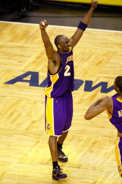 ORLANDO, FL - JUNE 14:  Kobe Bryant #24 of the Los Angeles Lakers celebrates as the Lakers' defeat the Orlando Magic in Game Five of the 2009 NBA Finals on June 14, 2009 at Amway Arena in Orlando, Florida.  The Lakers won 99-86.  NOTE TO USER:  User expre
