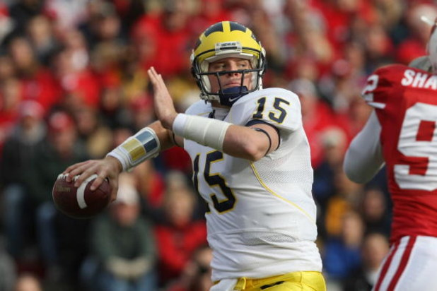 MADISON - NOVEMBER 10:  Ryan Mallett #15 of the Michigan Wolverines fades back to pass during the game against the Wisconsin Badgers at Camp Randall Stadium on November 10, 2007 in Madison, Wisconsin. (Photo by Jonathan Daniel/Getty Images)