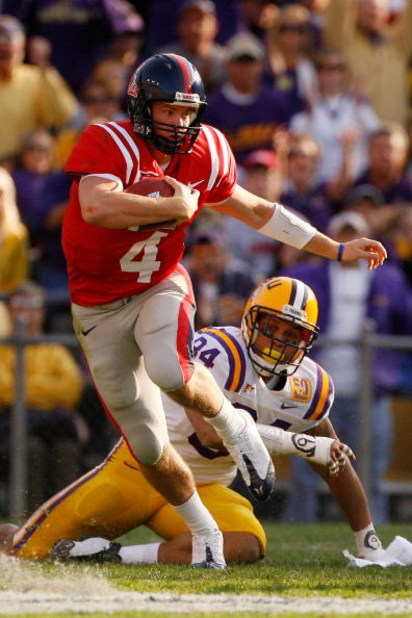 BATON ROUGE, LA - NOVEMBER 22:  Quarterback Jevan Snead #4 of the Ole Miss Rebels scrambles after a missed tackle by Rahim Alem #84 of the Louisiana State University Tigers  on November 22, 2008 at Tiger Stadium in Baton Rouge, Louisiana.  (Photo by Chris