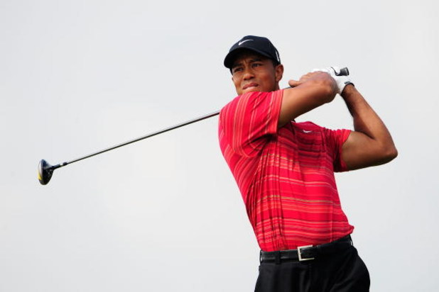 CHASKA, MN - AUGUST 16:  Tiger Woods watches his tee shot on the first hole during the final round of the 91st PGA Championship at Hazeltine National Golf Club on August 16, 2009 in Chaska, Minnesota.  (Photo by Sam Greenwood/Getty Images)