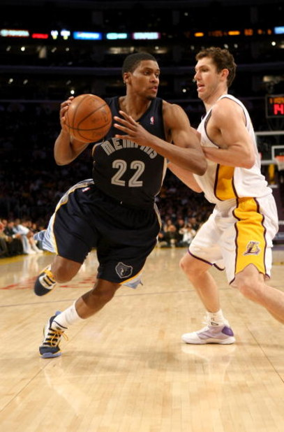 LOS ANGELES - APRIL 12: Rudy Gay #22 of the Memphis Grizzlies drives around Luke Walton #4 of the Los Angeles Lakers on April 12, 2009 at Staples Center in Los Angeles, California. The Lakers won 92-75. NOTE TO USER: User expressly acknowledges and agrees